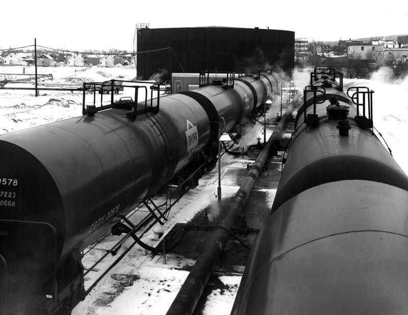 oil tank cars getting filled.jpg